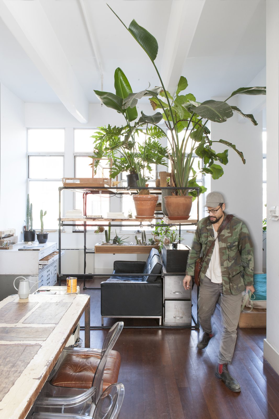 The apartment's centerpiece is a dining table made from wood reclaimed from a variety of projects.  Photo 3 of 5 in Huy Bui's Brooklyn Loft Is Like a Self-Contained Jungle