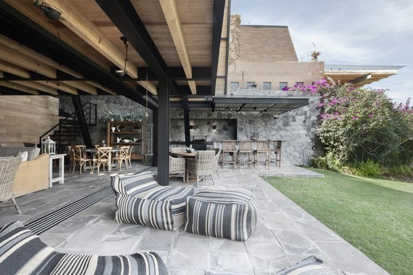 Group vacations are great for splitting travel costs, but not so good for getting restful alone time. That's why architecture studio Método used vertical space to divvy up a shared vacation house outside Mexico City.  Patio from Grade-A Getaway Outside Mexico City