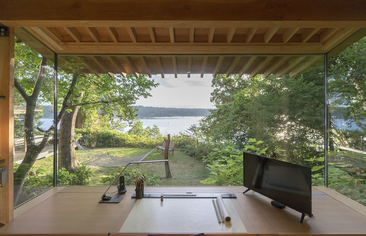 Office, Desk, Lamps, Craft Room Room Type, and Study Room Type The workstation and the cabinets are by Korben Mathis Woodworking; the desk lamp is  from TaoTronics.  Best Photos from An Architect and His Preteen Daughter Built This Tiny Backyard Retreat Together
