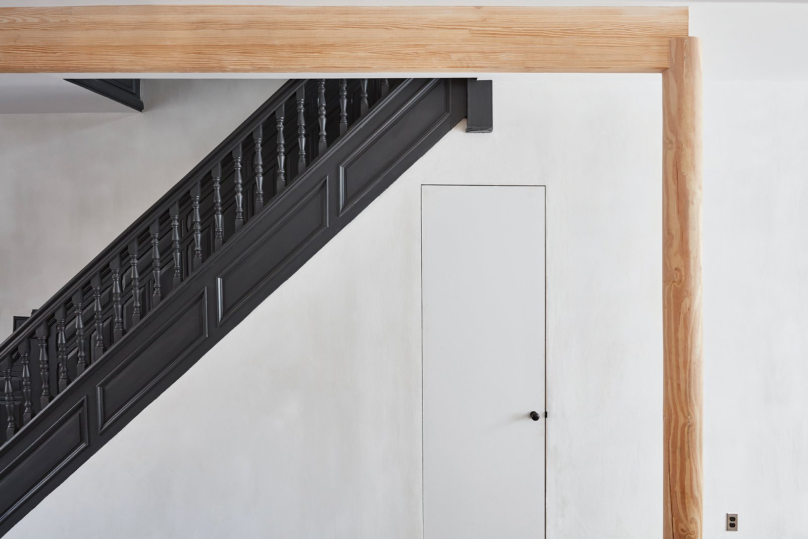 One of the brownstone's only remaining original features is the staircase. Tagged: Staircase, Wood Tread, and Wood Railing.  Ceilings from Forever Changes