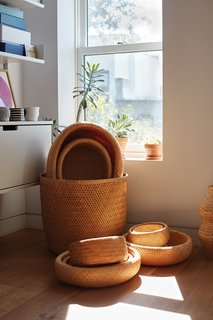 A Vitsœ shelving system and a  collection of bamboo baskets made in Vietnam occupy a sunny corner in the office that Lauren and Keith share on the top floor.