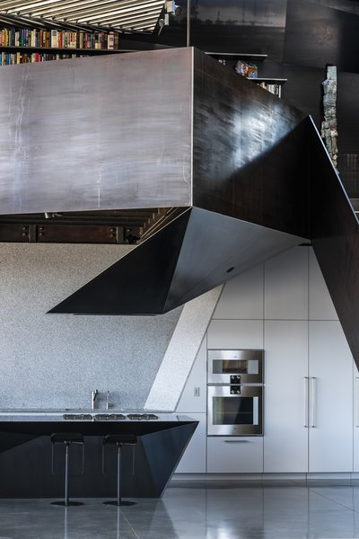 The kitchen features appliances by Gaggenau, a faucet by KWC, and barstools by Shin and Tomoko Azumi.
