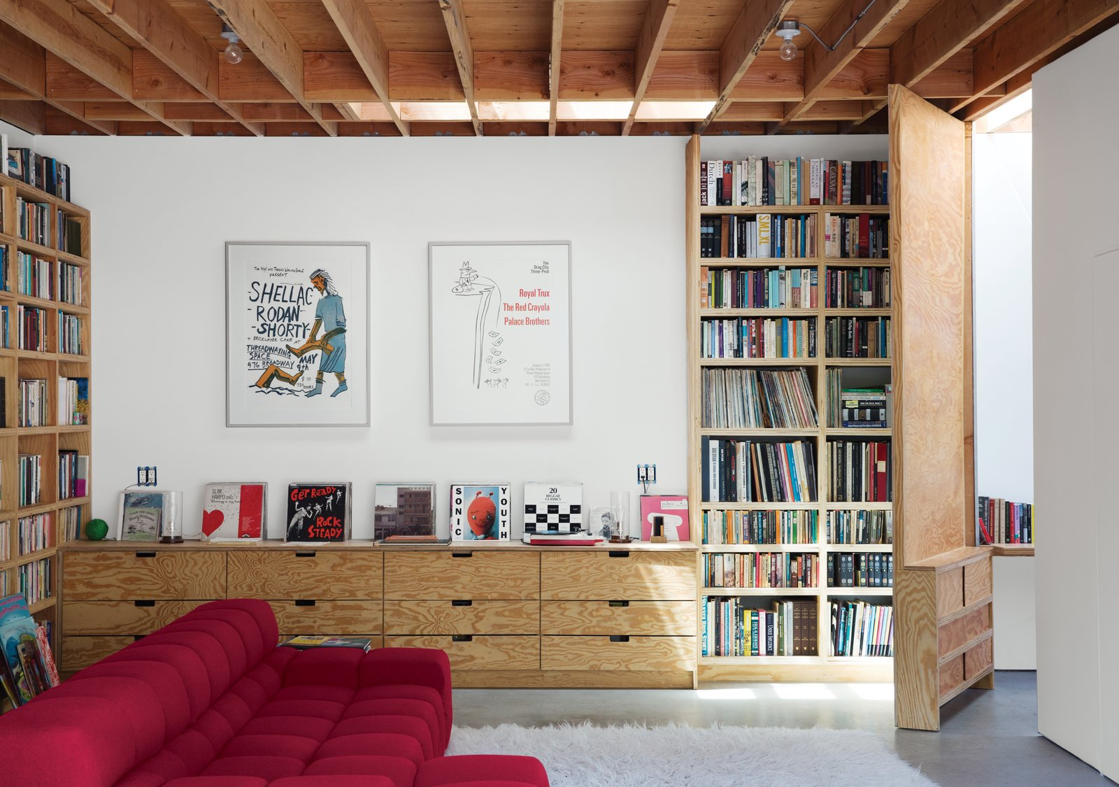 Garage, Garage Conversion Room Type, and Living Room Room Type After a tree falls in Santa Monica, a garage is reborn as a 600-square-foot family gathering spot.  30+ Modern Homes With Libraries by Matthew Keeshin