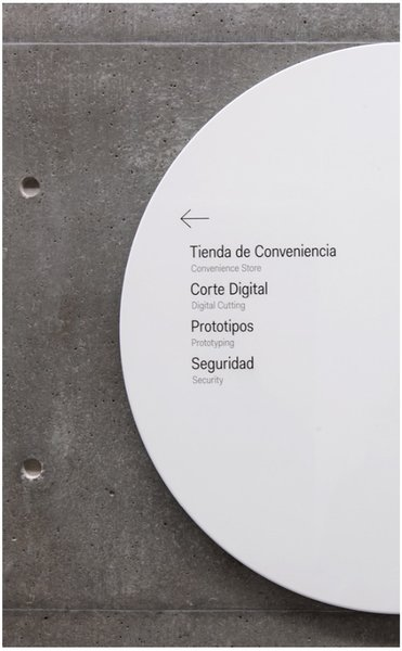 Typography is carefully composed on the simple circular shape and set in the Fakt font.  Way-Finding Systems