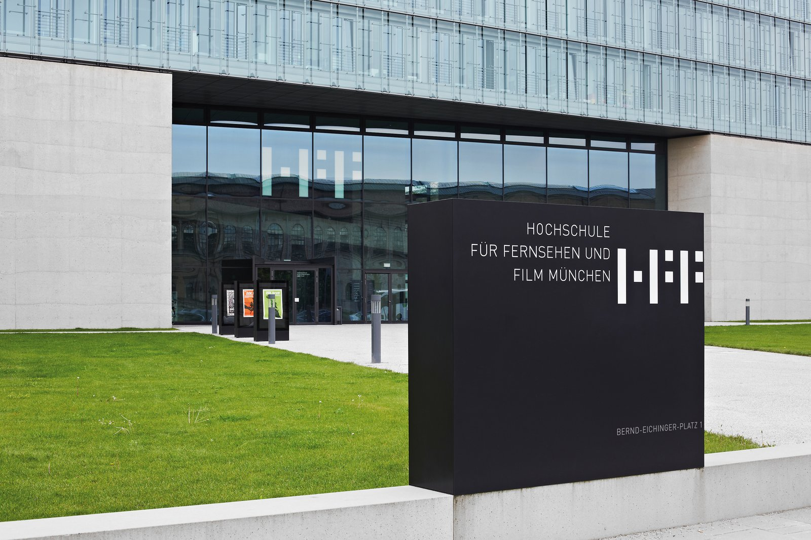 University of Television and Film Munich: To ensure easy orientation, the university's logo and important information were applied, almost like projections, directly onto the concrete and glass facades for high visibility.  Way-Finding Systems