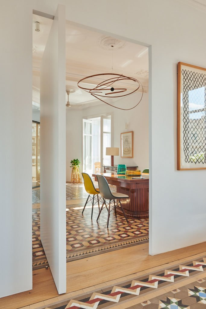 Hallway, Light Hardwood Floor, and Ceramic Tile Floor Photo courtesy of Built Architecture   Eames Molded Chairs from Tile