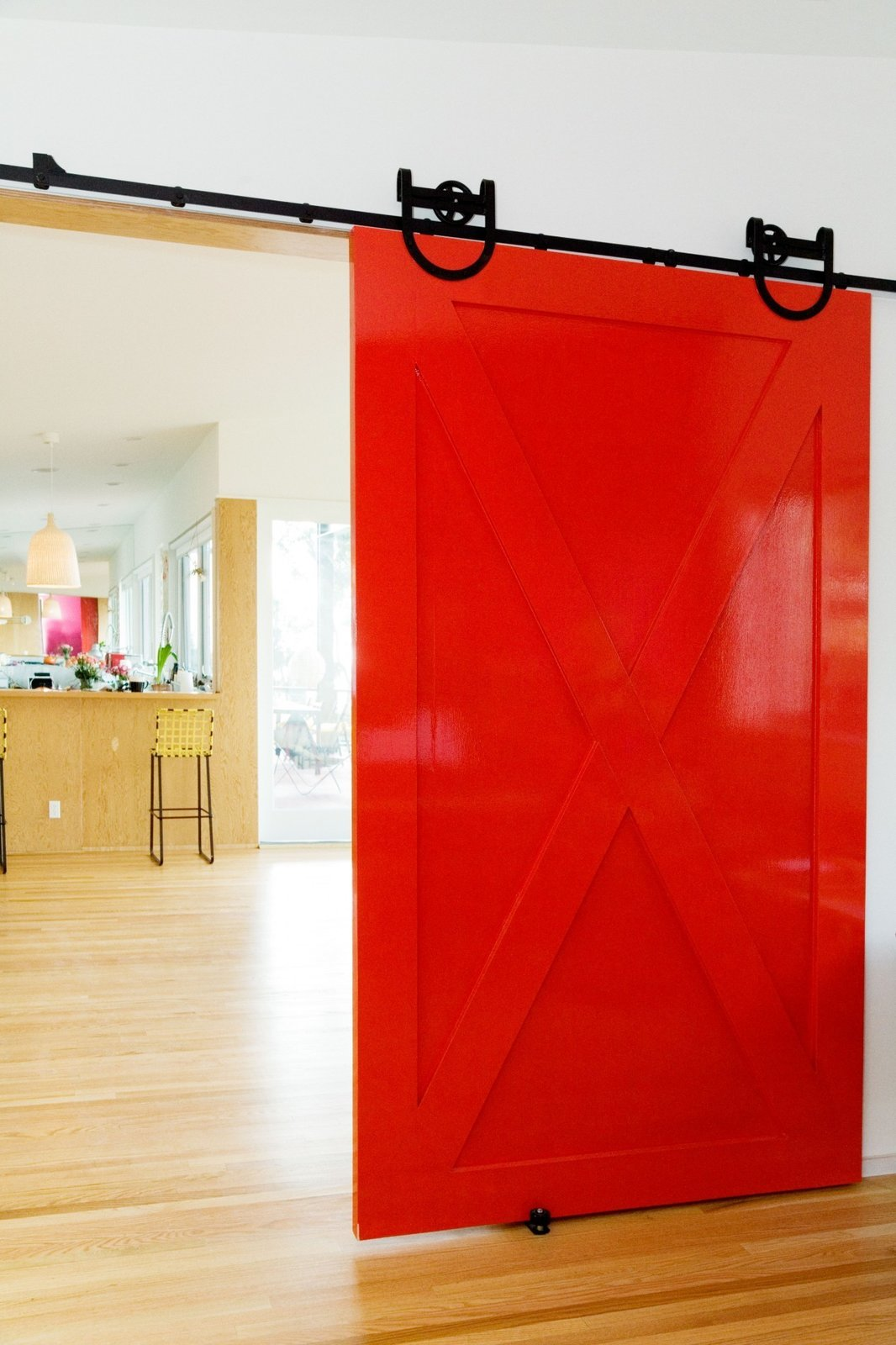 red sliding barn door on black rail
