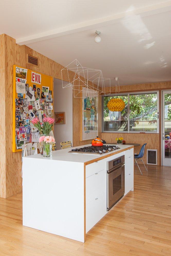 #SwanHouse #renovation #remodel #1950s #modern #interior #inside #kitchen #island #stove #lighting #color #windows #2013 #LosAngeles #California #BarbaraBestor  60+ Modern Lighting Solutions by Dwell