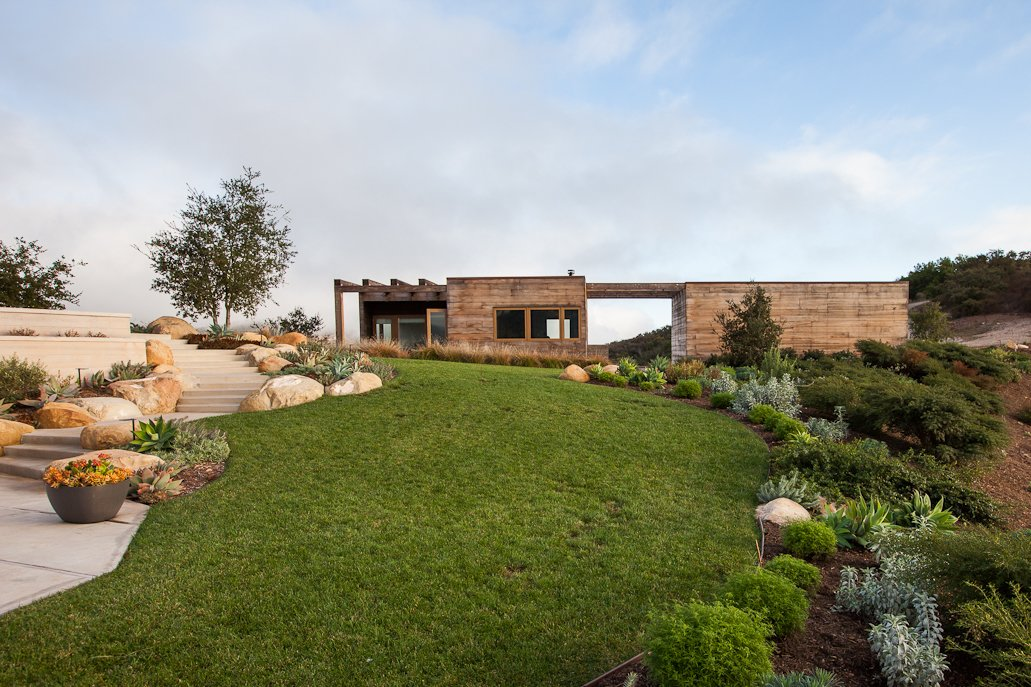 Back Yard, Grass, Exterior, Wood, and House #ToroCanyonHouse #residence #modern #midcentury #exterior #outside #landscape #view #2012 #SantaBarbaraCounty #BarbaraBestor   Exterior Grass Wood Photos from Toro Canyon House
