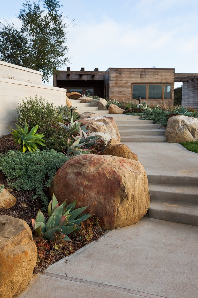 Boulders, Walkways, Exterior, Concrete, House, and Wood #ToroCanyonHouse #residence #modern #midcentury #exterior #outside #staircase #landscape #2012 #SantaBarbaraCounty #BarbaraBestor   Best Exterior House Concrete Photos from Toro Canyon House