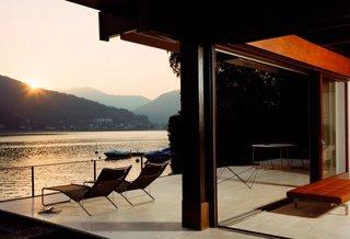 #CarabiettaHouse #modern #residence #exterior #outside #windows #lake #seating #view #lake #loungechairs #outdoors #BassamFellows