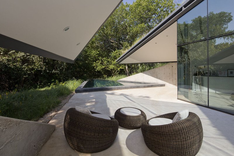 #EdgelandHouse #residence #modern #sunken #pithouse #seating #structure #exterior #outside #outdoors #structure #BercyChenStudio  Edgeland House by Bercy Chen Studio