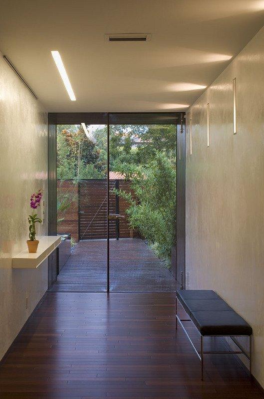 #PeninsulaResidence #lakeside #glass #steel #materials #modern #hallway #doorway #window #seating #structure #interior #inside #indoors #LakeAustin #BercyChenStudio  The Peninsula Residence