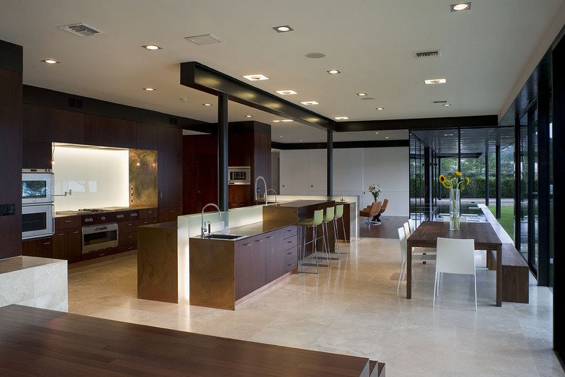 #PeninsulaResidence #lakeside #glass #steel #materials #modern #structure #kitchen #dining #island #barstools #table #windows #lighting #interior #inside #indoors #LakeAustin #BercyChenStudio  The Peninsula Residence
