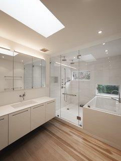 #LightboxWainscott #structure #form #stackedboxes #modern #interior #inside #indoors #bathroom #lighting #skylight #sink #shower #tub #wood #flooring #JaredDellavalle #BernheimerArchitects