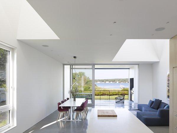 #QuonochontaugHouse #structure #form #coastal #indoor #inside #interior #modern #midcentury #livingroom #dining #seating #windows #naturallight #RhodeIsland #BernheimerArchitects