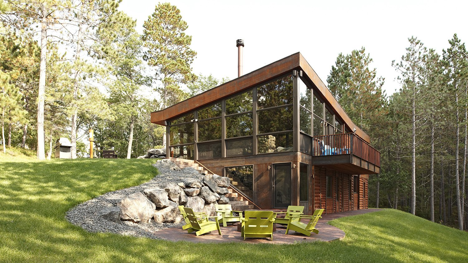 Exterior, Cabin Building Type, House Building Type, Wood Siding Material, Metal Siding Material, Shed RoofLine, and Glass Siding Material #FamiliarCabin #cabin #minimal #wood #exterior #deck #retreat #outdoor #forest #architecture #modern #modernarchitecture #landscapearchitecture #CityDeskStudio  Photo 66 of 101 in 101 Best Modern Cabins