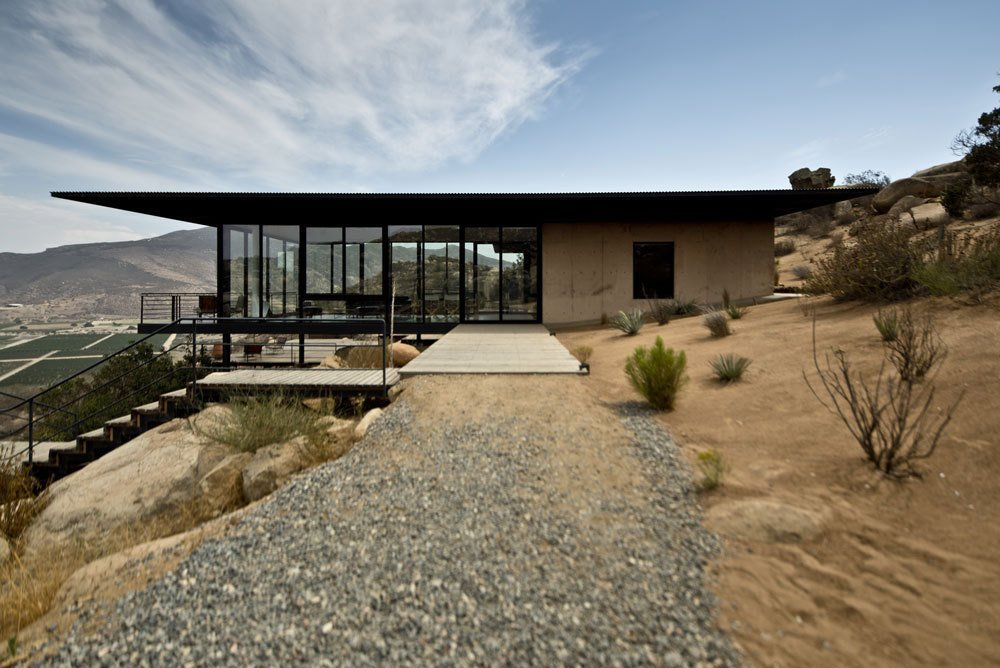 #outdoor #exterior #outside #landscape #concrete #desert #modern #glass #home #stairs #window #Baja #California #GraciaStudio  Photo 17 of 23 in 20 Desert Homes from Casa Guadalupe