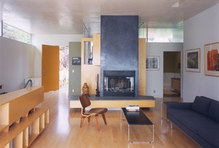 #interior #inside #indoor #livingroom #fireplace #Eames #LCW #couch #modern #midcenturymodern #wood #clean #SantaMonica #California #KevinDalyArchitects
