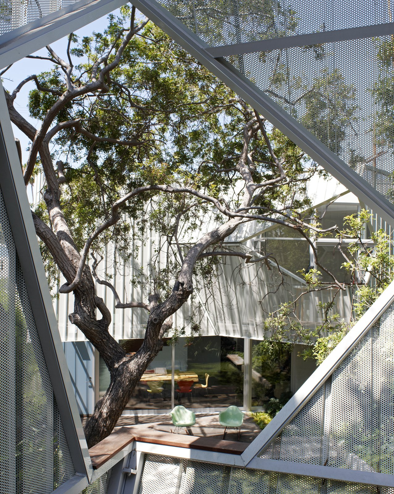 #outside #exterior #outdoor #geometry #Eames #rockingchair #tree #landscape #color #aluminum #metal #eco #green #sustainable #Venice #California #KevinDalyArchitects  Venice Residence by Kevin Daly Architects