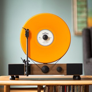How about this upright record player to start a conversation' or to brighten a living room with sound, color, and style?