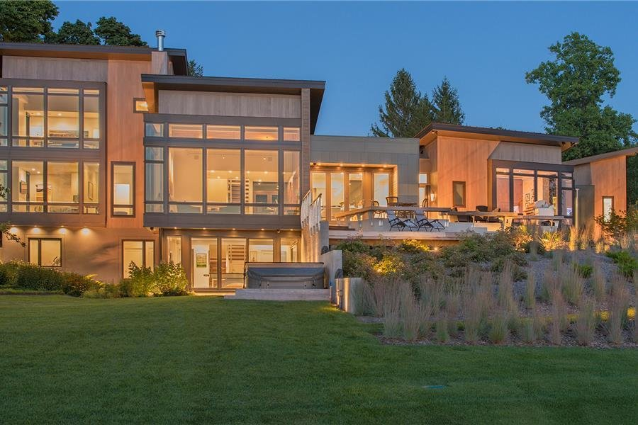 Photo courtesy of Holmes, King, Kallquist & Associates provided by Marvin Windows and Doors; project submitted to 2017 Marvin Architects Challenge Tagged: Outdoor, Trees, Grass, Shrubs, Large Patio, Porch, Deck, Back Yard, and Landscape Lighting.  Modern Waterfront Residence