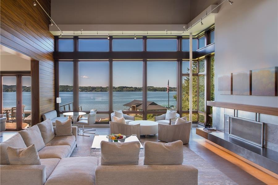 Living Room, Sectional, Chair, and Ceiling Lighting Photo courtesy of Holmes, King, Kallquist & Associates provided by Marvin Windows and Doors; project submitted to 2017 Marvin Architects Challenge  Modern Waterfront Residence
