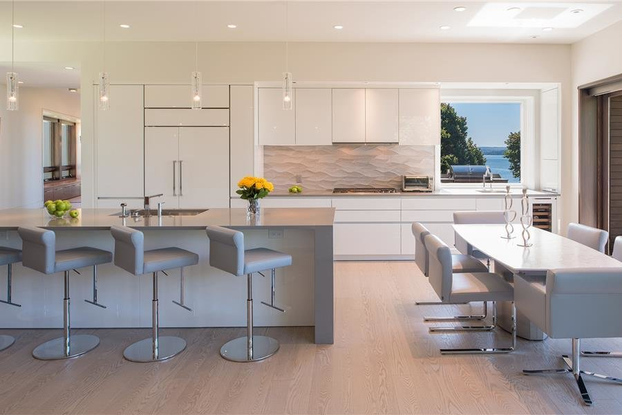 Kitchen, Ceiling Lighting, and Refrigerator Photo courtesy of Holmes, King, Kallquist & Associates provided by Marvin Windows and Doors; project submitted to 2017 Marvin Architects Challenge  Modern Waterfront Residence