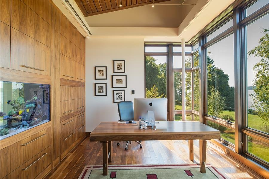 Office, Desk, Study Room Type, and Medium Hardwood Floor Photo courtesy of Holmes, King, Kallquist & Associates provided by Marvin Windows and Doors; project submitted to 2017 Marvin Architects Challenge  Modern Waterfront Residence