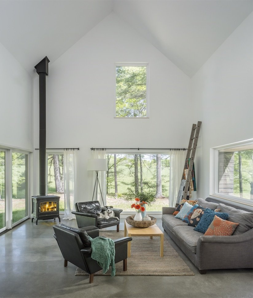 Living Room, Corner Fireplace, Sofa, Chair, Floor Lighting, and Coffee Tables Architect Elizabeth Herrmann's Knoll House project, Best Transitional category winner of 2017 Marvin Architects Challenge.    Knoll House
