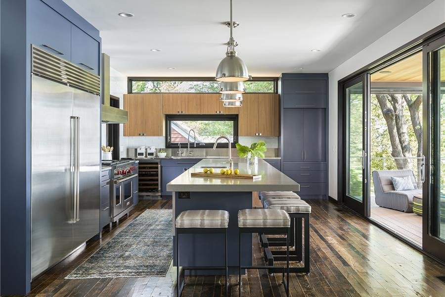 Kitchen, Ceiling Lighting, Refrigerator, Range Hood, Range, and Wine Cooler Photo courtesy of Rehkamp Larson Architects provided by Marvin Windows and Doors   Lake Edge