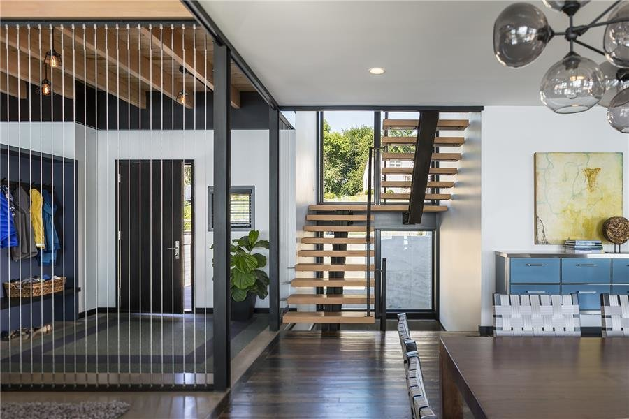 Photo courtesy of Rehkamp Larson Architects provided by Marvin Windows and Doors Tagged: Staircase.  Lake Edge