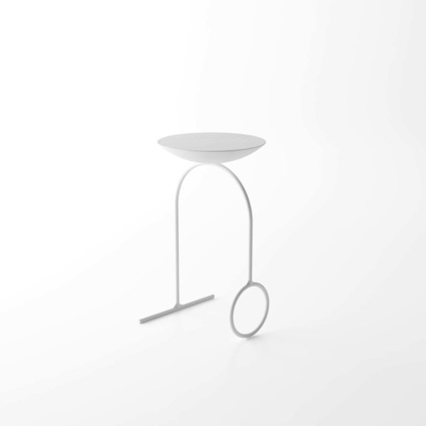 Giro is a minimal table created by Brazil-based designer Pedro Paulo-Venzon. The project serves to be multifunctional, and can be used as either a table or stool. The work is illustrated through clean lines and simple forms. The surface rests atop a curved metal frame that is composed of a circle and line that form its legs. From the side profile, the legs appear to have a simple U-shaped form. The design is available in either black or white.