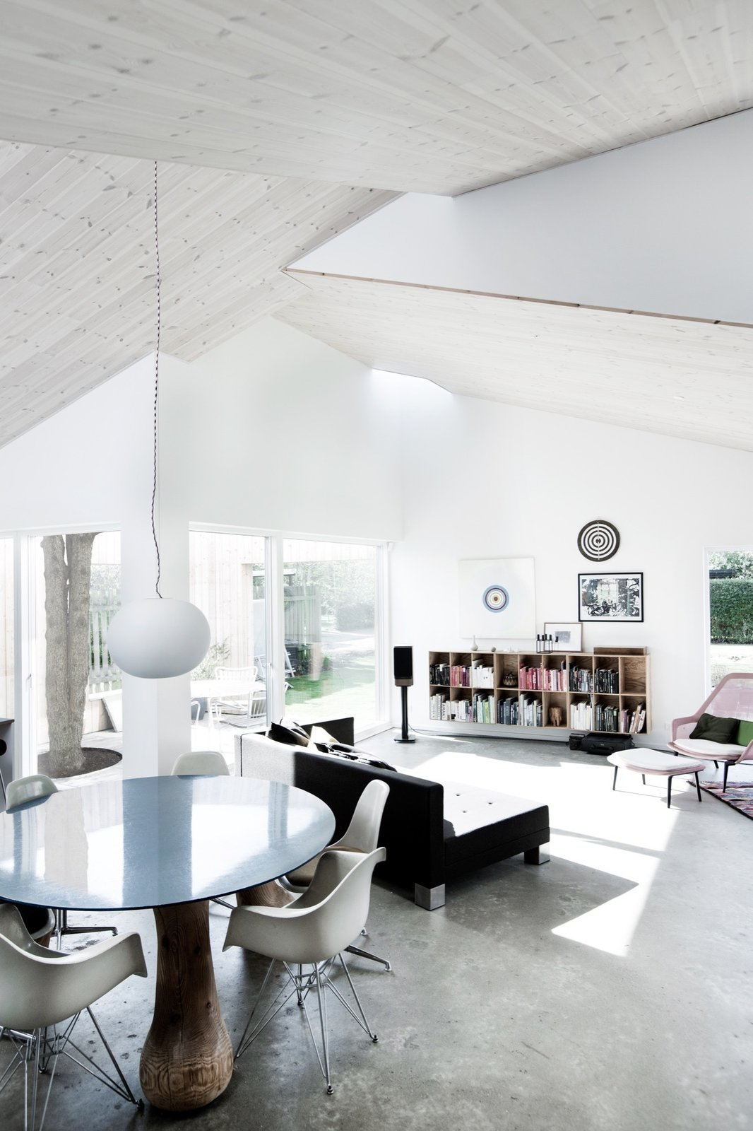 Living Room, Pendant Lighting, Chair, Table, and Concrete Floor Living area  The Roof House