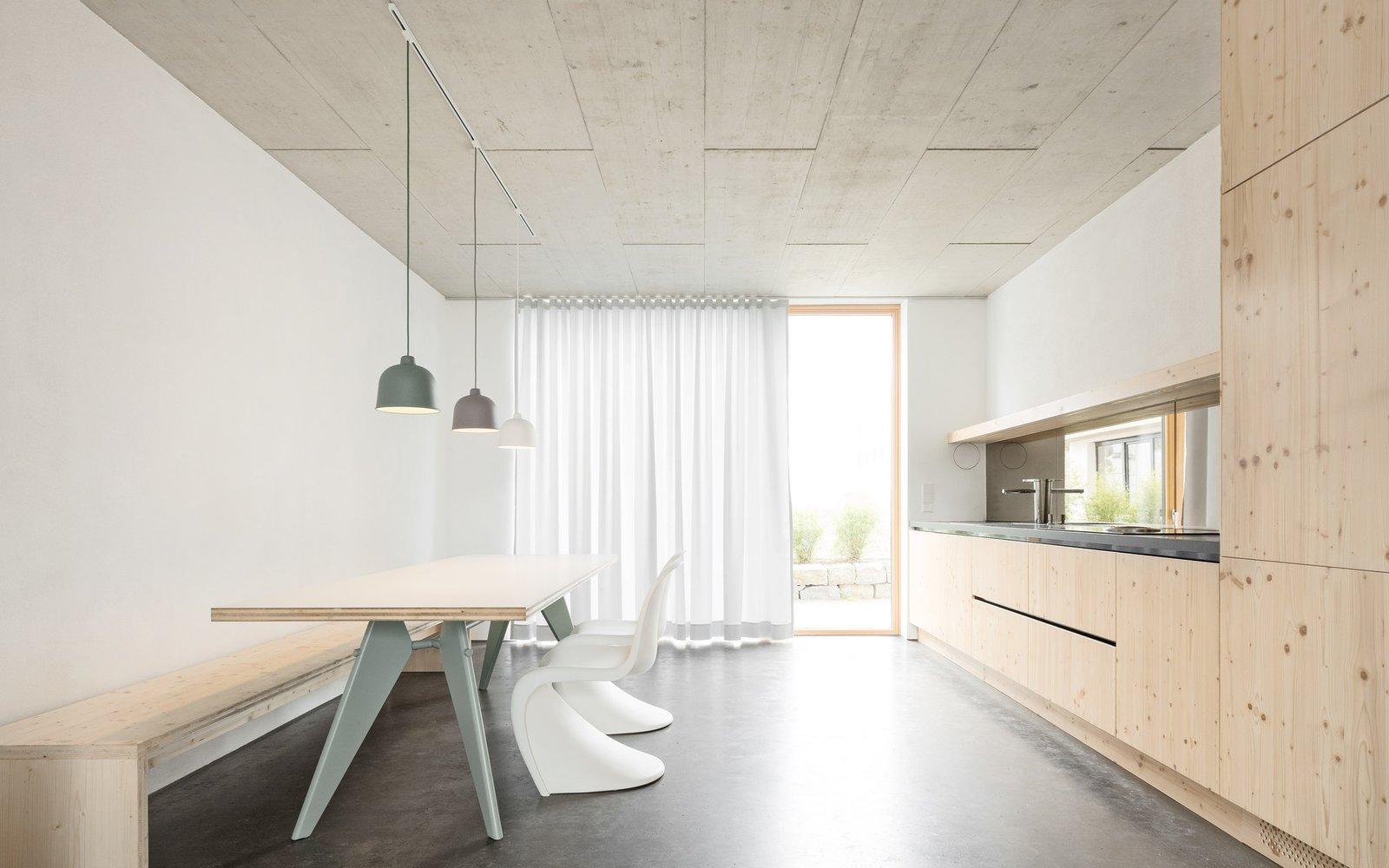 Kitchen, Concrete Floor, and Pendant Lighting Kitchen  Haus B