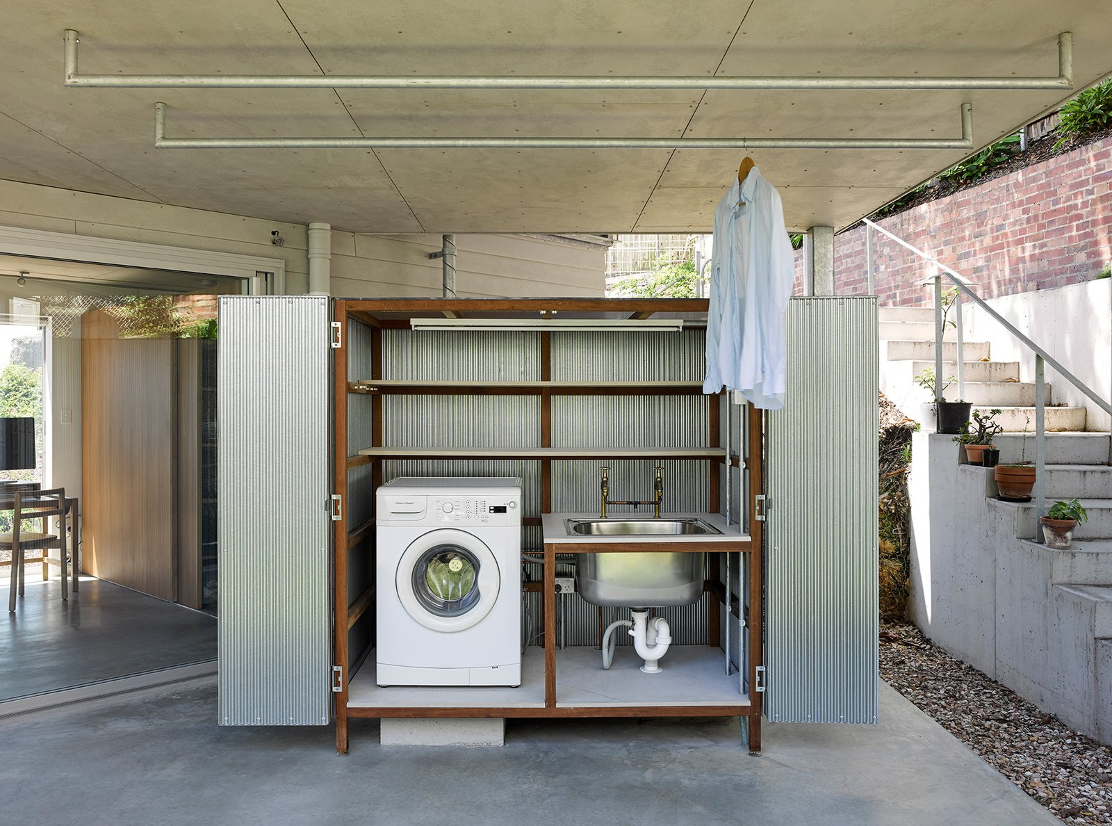 Laundry Room, Concealed, Metal Cabinet, and Metal Counter Half-loaded dishwashers or washing machines are a huge source of wastage, so wait until your machines are full before running your next cycle.  Best Photos from House in Hamilton