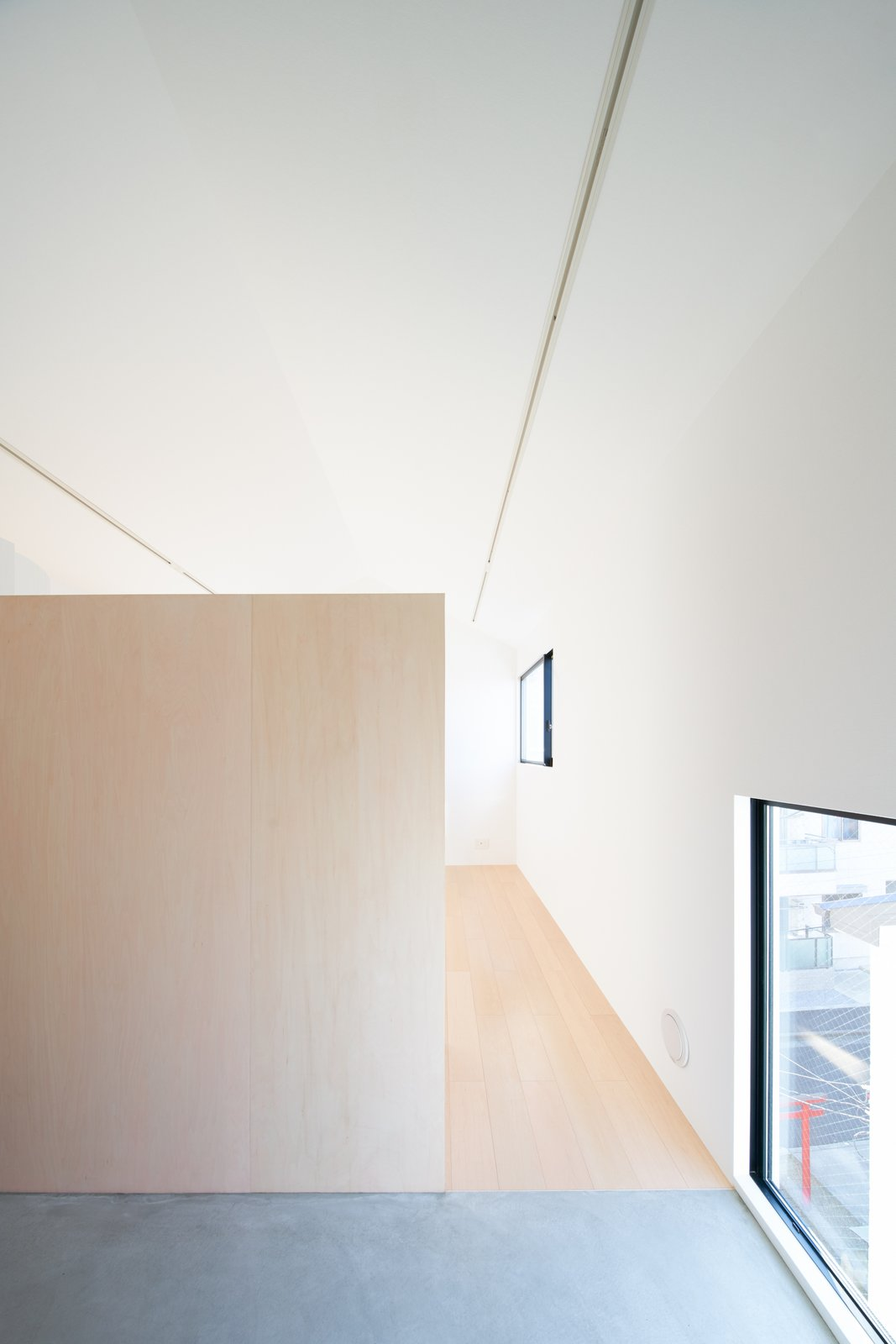 MWP15 is a collective housing complex located in Chiba, Japan, designed by SO&CO. The property is situated on a deformed site facing the elevated Kesei Line. The architects wanted to create to L-shaped volumes that would be arranged to have a small courtyard in the middle. In order to expand the interiors, the architects decided to use thinner wall insulation through the use of a steel wall refractory. The interiors feature light wood and concrete flooring to clearly delineate the internal programs.  Interiors