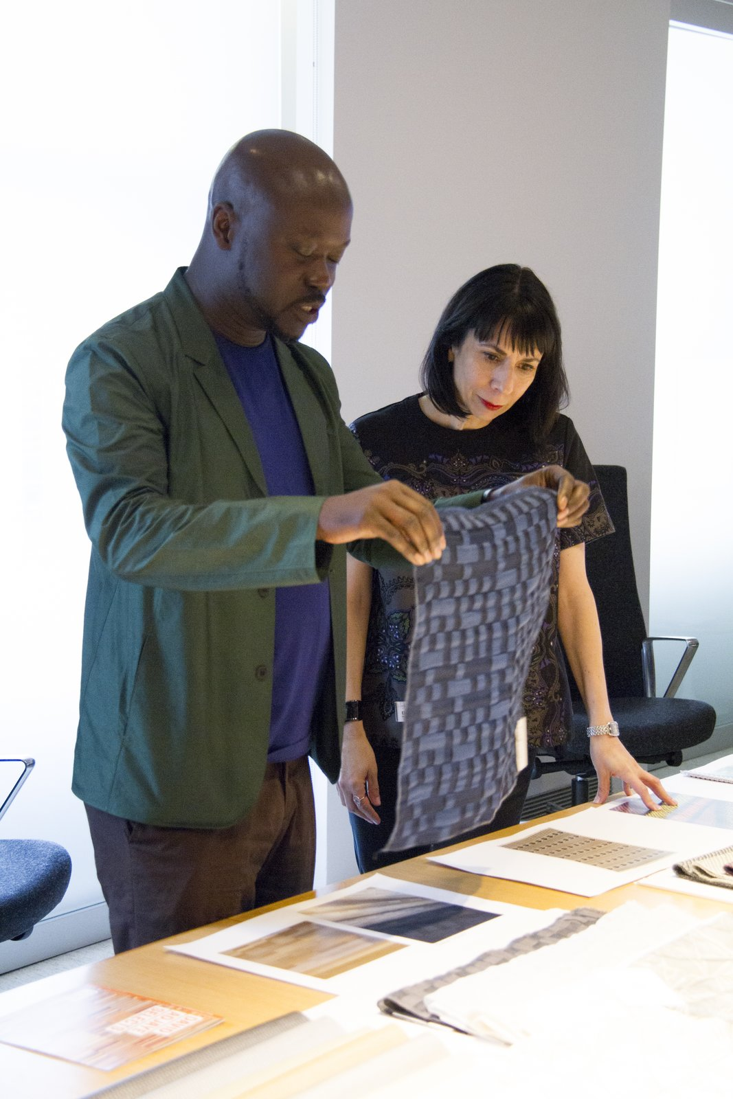 David Adjaye with Dorothy Cosonas reviewing Dakar drapery from The Adjaye Collection for KnollTextiles. Photography by KnollTextiles.  Photo 4 of 7 in Knoll Inspiration: In Conversation with David Adjaye