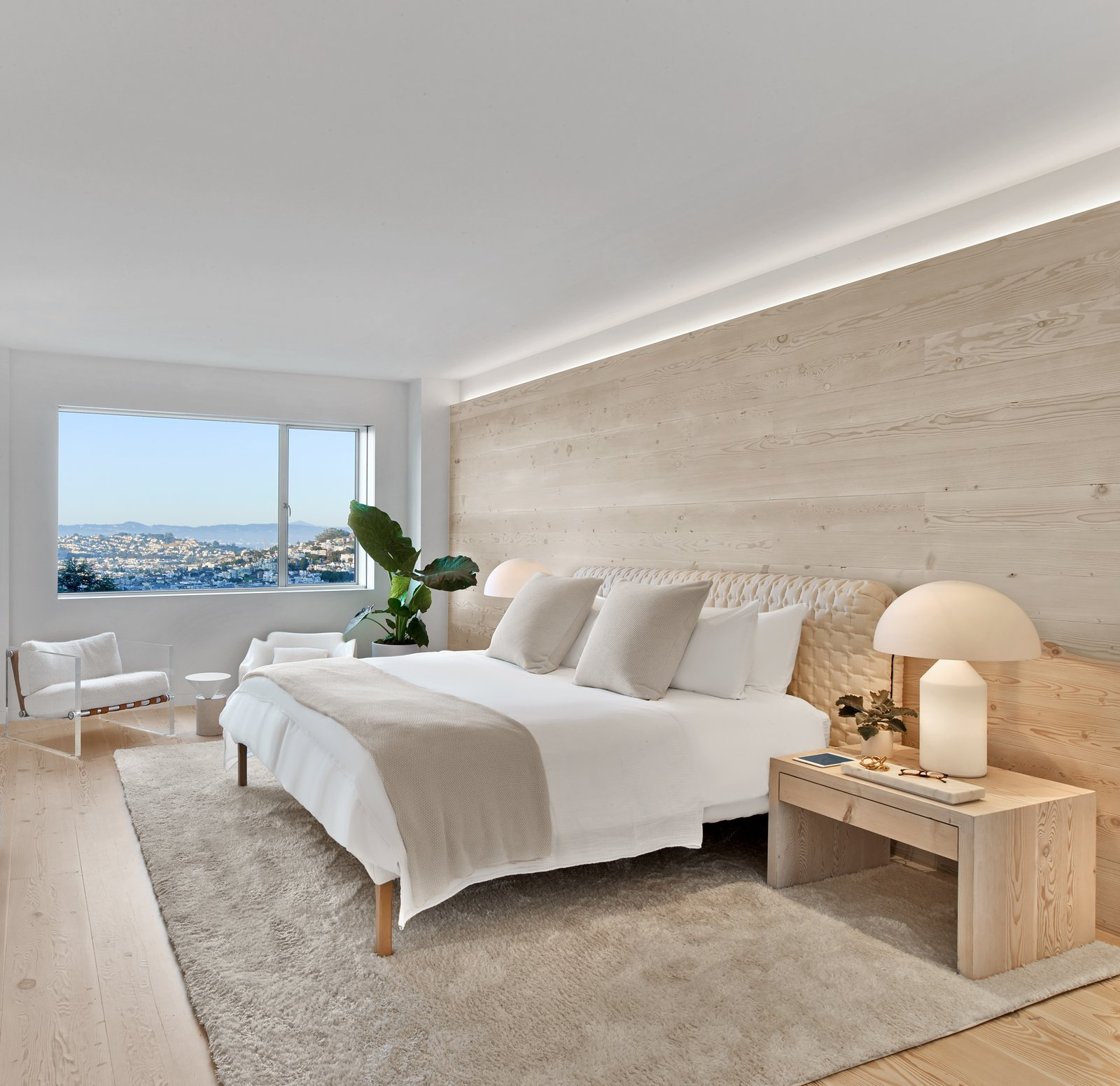 Bedroom, Bed, Table Lighting, Night Stands, Accent Lighting, Carpet Floor, and Light Hardwood Floor Master bedroom  Glen Park Residence by CCS ARCHITECTURE
