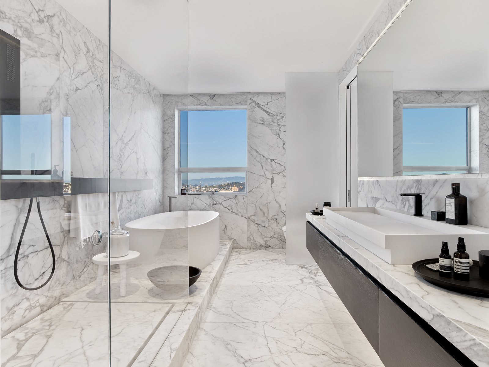 Bath Room, Marble Floor, Vessel Sink, Freestanding Tub, Marble Counter, Soaking Tub, Enclosed Shower, Corner Shower, and Marble Wall Master bath  Glen Park Residence by CCS ARCHITECTURE