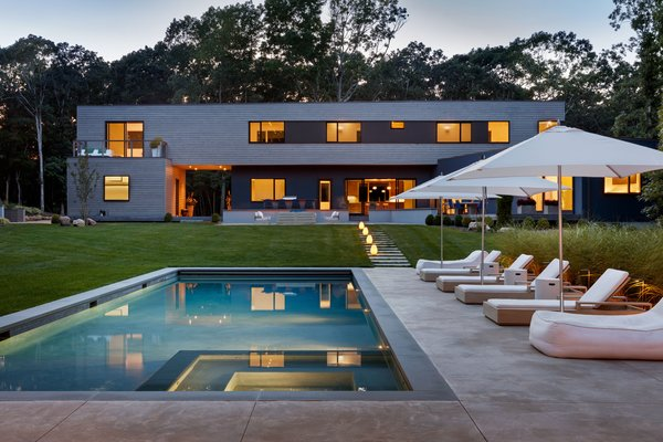 rear facade and yard, view from poolhouse