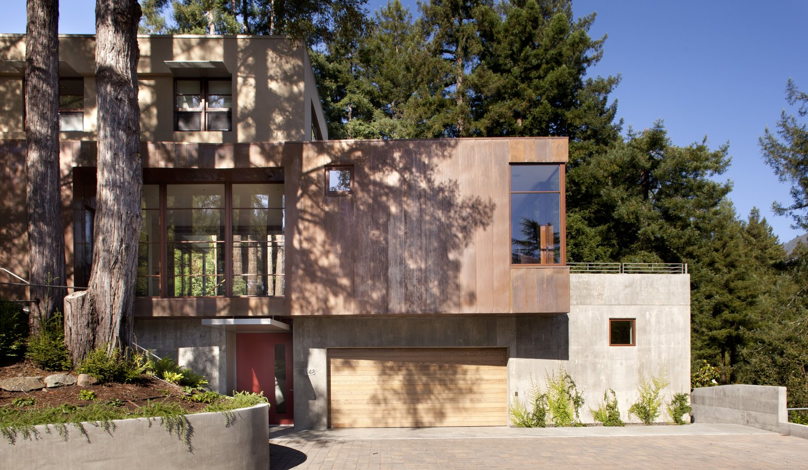 Exterior, House Building Type, Metal Siding Material, Concrete Siding Material, and Flat RoofLine copper & concrete facade  Best Photos from Mt. Tam House
