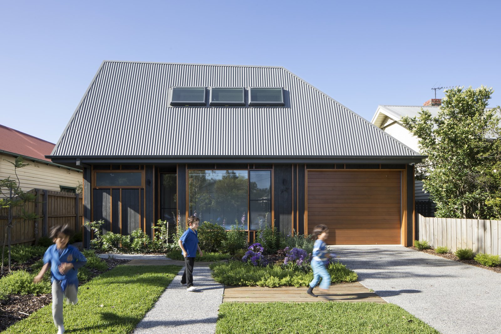 Exterior, Metal Roof Material, House Building Type, and Wood Siding Material Porjazoski thought that reinterpreting a traditional pitched roof in a highly angled metal form would be  Photo 2 of 10 in A Family Home in Australia Features a Playful Version of the Classic Pitched Roof