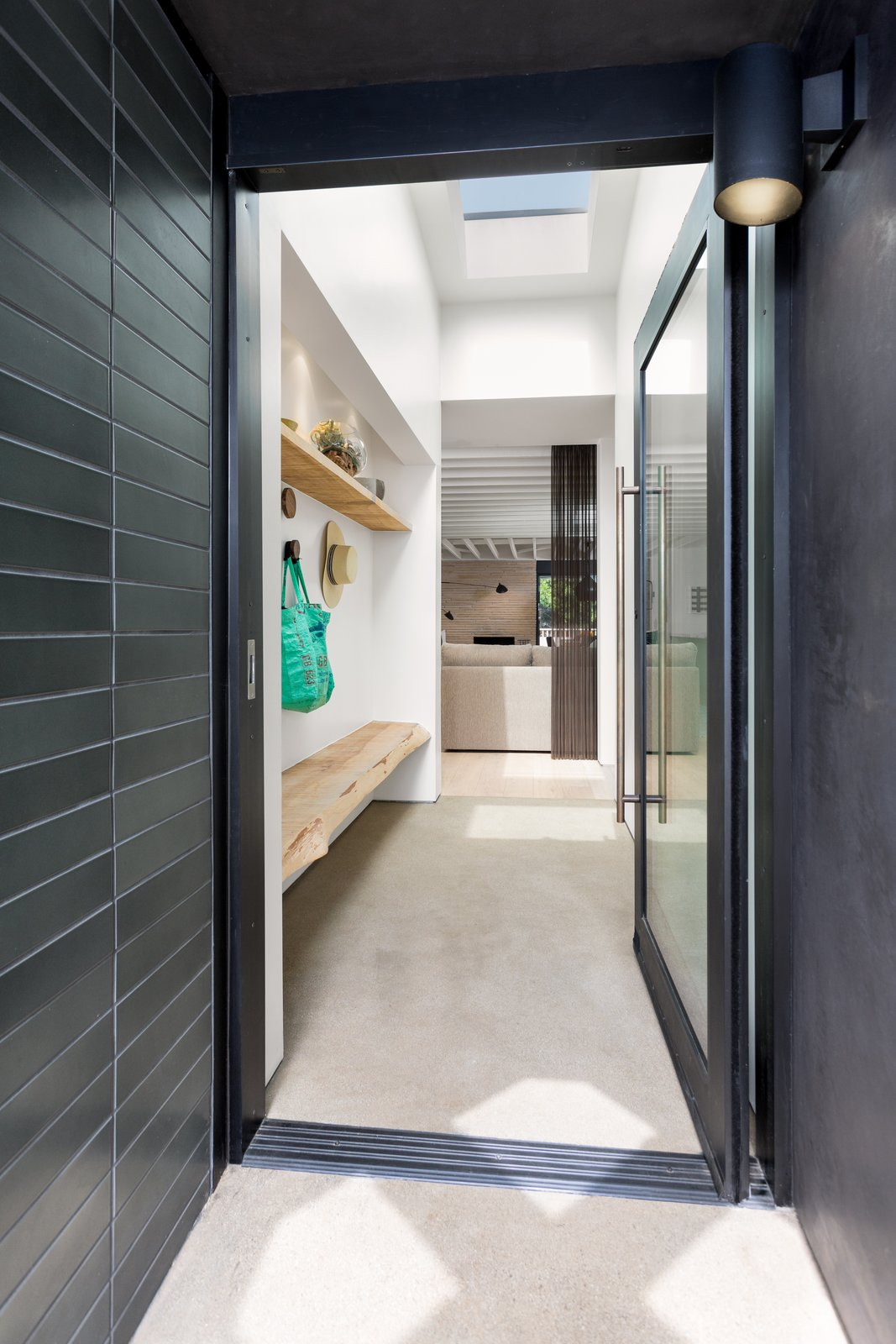 Hallway and Concrete Floor Benjamin Moore's  Photo 3 of 12 in The Woman Who Grew Up in This L.A. Home Returned to Give it a Stunning Renovation