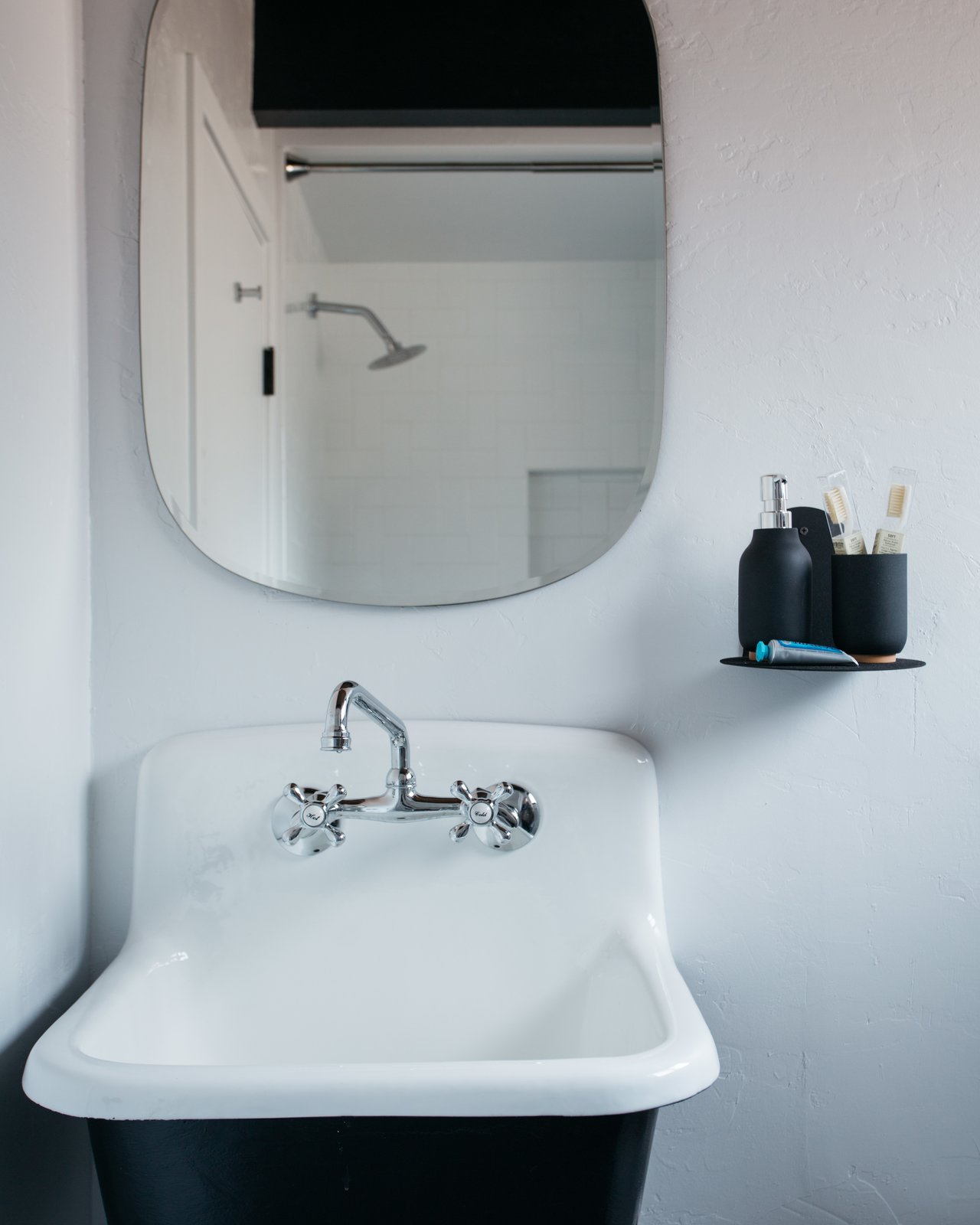 """Bath Room and Wall Mount Sink """"We borrowed from a bohemian look for the bedrooms, and opted for a rustic look for the bathroom,  Photo 13 of 13 in A 1970s A-Frame Cabin in Big Bear Is Brought Back to Life"""