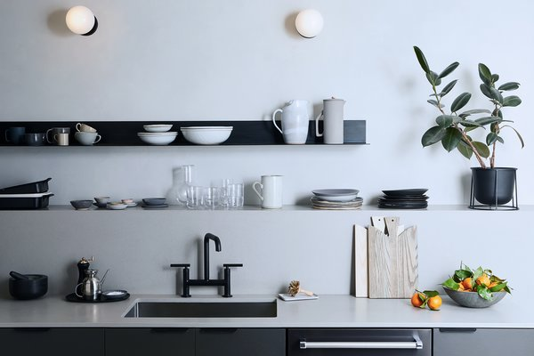 It is important to remember that just because you use an item regularly doesn't mean it has to be displayed. If the item doesn't match the other kitchenware you're opting to showcase, it won't naturally blend in.