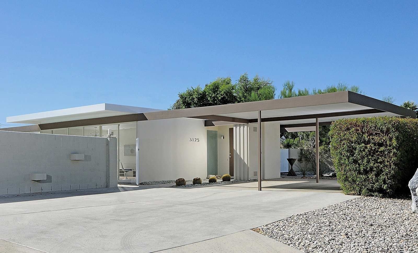 Exterior, Flat, Concrete, House, Metal, Metal, and Mid-Century Wexler and Harrison's original plan was to create affordable vacation homes for a growing middle class. When this home first went on the market with the others in 1962, it was competitively priced between $13,000 and $17,000.  Best Exterior Metal Mid-Century Flat Concrete Photos from You Can Now Buy One of Palm Springs's Most Historic Homes For $839K