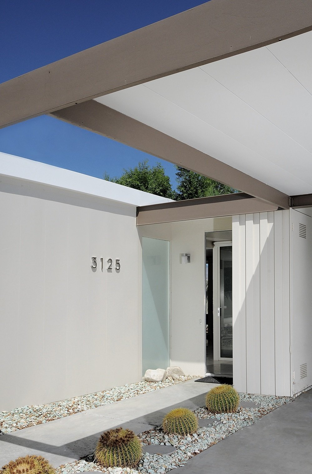 Exterior, Metal, Metal, House, Flat, Concrete, Glass, and Mid-Century The longtime owner updated the landscaping in 2001 with Wexler's oversight.  Best Exterior Metal Mid-Century Photos from You Can Now Buy One of Palm Springs's Most Historic Homes For $839K
