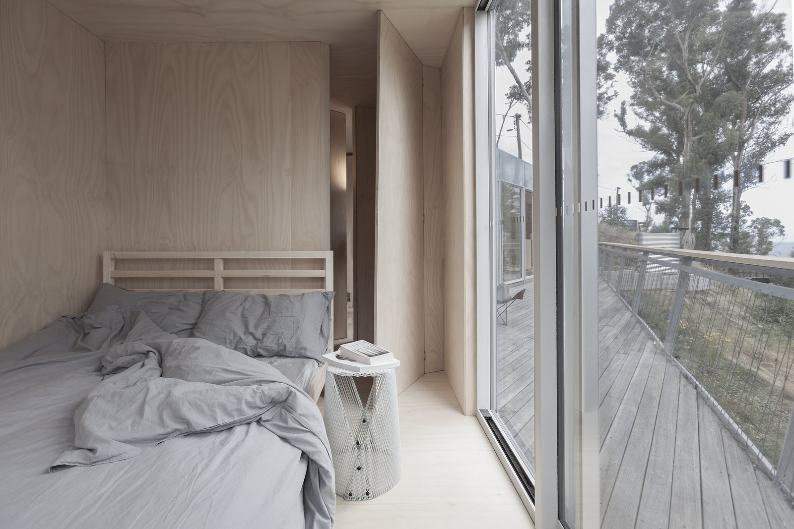 Bedroom, Plywood Floor, Night Stands, and Bed The two bedrooms were made to be equally simplistic, with just enough to feel comfortable.  Photo 5 of 8 in This Off-Grid Container Home in Australia Disappears in Nature