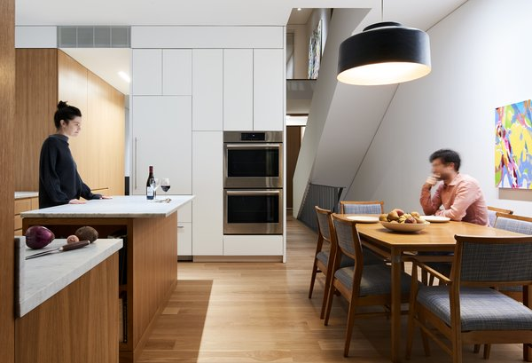 """Shane came to the project with a """"lifetime of ideas,"""" he says, although the prospect of taking on an entire property's renovation was daunting. He kept the kitchen simple and used drywall and oak for much of the detailing."""